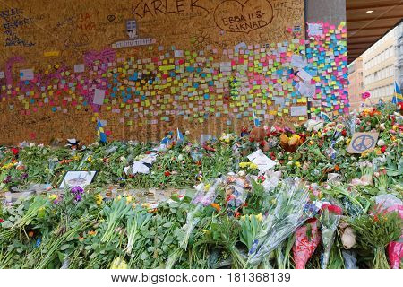 STOCKHOLM SWEDEN - APR 12 2017: Lots of flowers and messages on post-it notes in central Stockholm where the lorry crashed from people paying respect to the victims in the terror attack in Stockholm April 07 2017. April 13 2017 in Stockholm Sweden