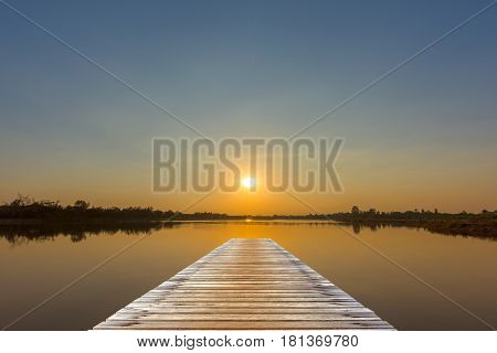 View from a wooden bridge and sunset over the lake