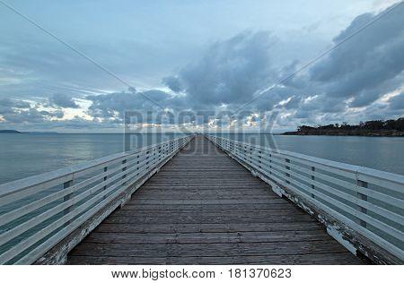 San Simeon Public Pier under sunset cloudscape on the Central Coast of California USA