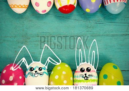 easter eggs arranged on wooden surface