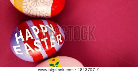 Easter greeting against various easter eggs arranged on pink background