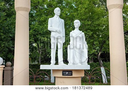 PETROPAVL, KAZAKHSTAN - JULY 24, 2015: Sculptures of the famous russian poets Nikolai Gumilev and Anna Akhmatova in the park. Petropavl is a city in northern Kazakhstan close to the border with Russia