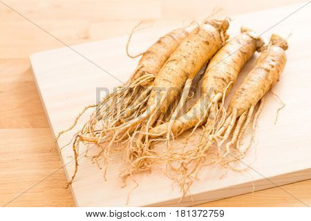 Fresh korean Ginseng over wooden background