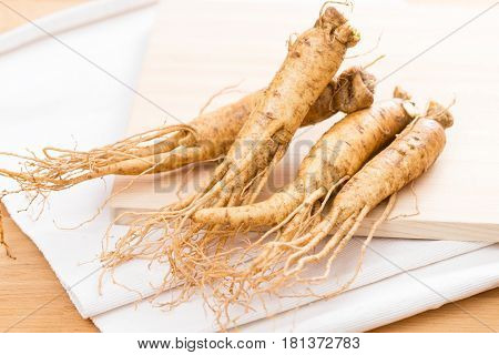 Korean Ginseng over wooden background