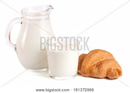 Jug and glass of milk with croissant isolated on white background.