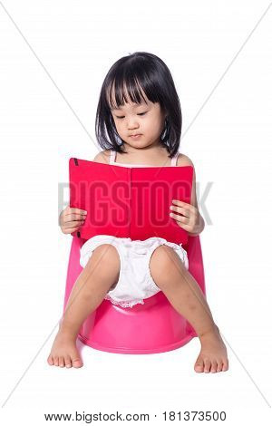 Asian Chinese Little Girl Sitting On Chamberpot With Book
