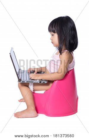 Asian Chinese Little Girl Sitting On Chamberpot With Laptop