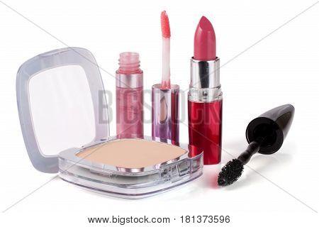 Make-up powder, lipstick, lip gloss and mascara isolated on white background.