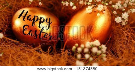 Easter greeting against golden easter eggs in nest