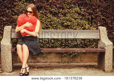 Smiling Girl Sitting On Bench.