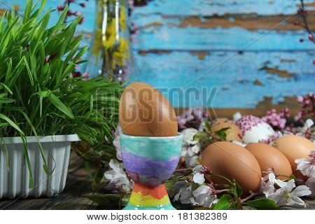 Painted Easter eggs and grass with cherry branch