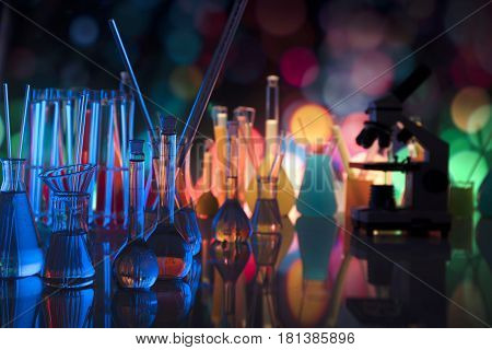 Laboratory theme.  Laboratory experiment. Test tubes, microscope. Scietific lab concept. Colorful bokeh.