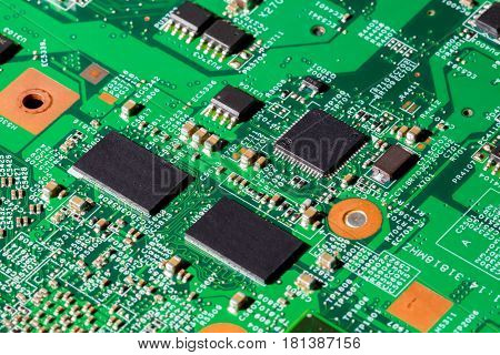 Close up shot of computer chips on a PCB