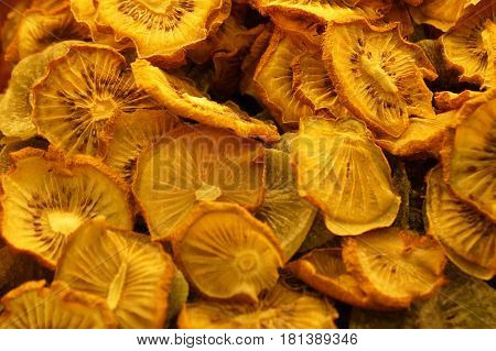 Dried chopped kiwi fruit. Kiwi fruit is dried. Dried fruit from kiwi fruit.