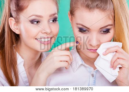 Sad Woman Crying And Being Consoled By Friend.
