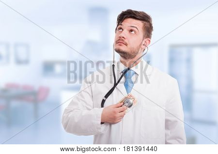Doctor Holding Money And Listening Heart With Stethoscope
