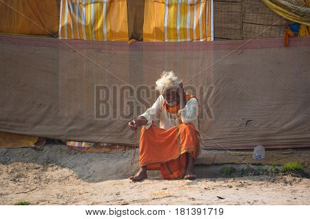 The Hermit, A Sadhu, Sits Meditating On The Holy River Ganges