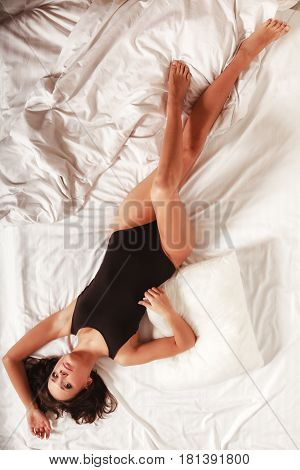 Sexy Girl Lazy Woman Lying On Bed In Bedroom