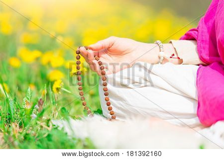 Recitation Of Mantras Holding The Mala During A Yoga Practice