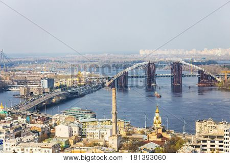 Aerial view of the Kiev city Kyiv Ukraine. Dnieper river and bridges. Podil.