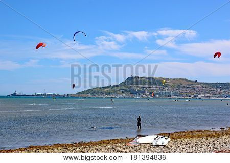 kitesurfers riding their boards in Portland harbour, Dorset