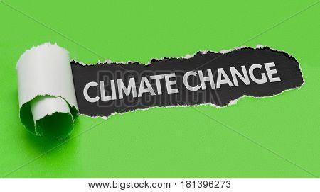 Torn green paper revealing the word Climate change
