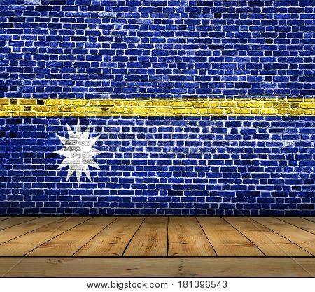Nauru flag painted on brick wall with wooden floor