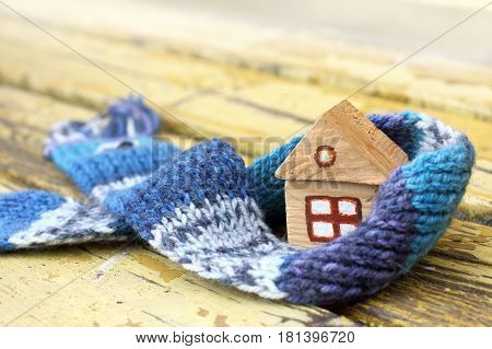 small wooden house in a warm blue scarf/ COZY dwelling at any season