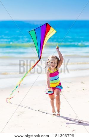 Child Flying Kite On Tropical Beach