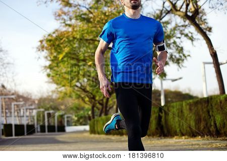 Athlete Running In The Park (with Little Motion Blur)