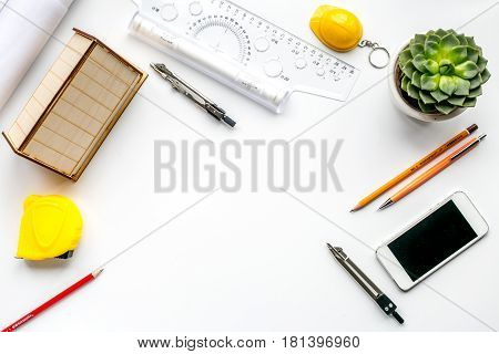 architect working desk with fower, mobile and ruler on white background top view mock up