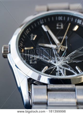 Broken stainless steel glass watch in concept of failure
