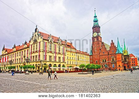 People At Two Halls On Market Square In Wroclaw