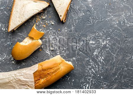 fresh sandwich and baguette on gray table background top view mock-up