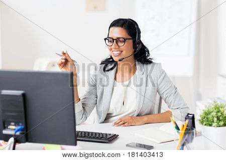 communication, business, people and technology concept - smiling businesswoman or helpline operator with headset and computer at office