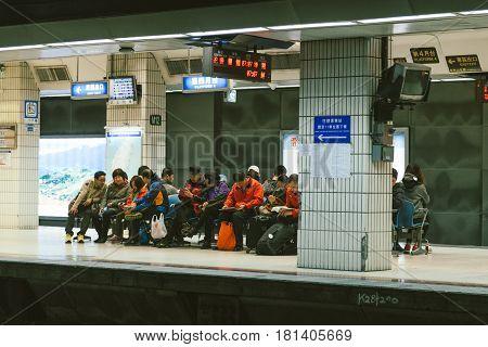 Taipei Taiwan26 Dec2014 - people waiting in the paltform of Taipei station