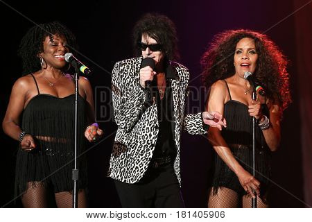 HUNTINGTON, NY-AUG 30: Singer Peter Wolf (C) of the J. Geils Band performs onstage at The Paramount on August 30, 2015 in Huntington, New York.