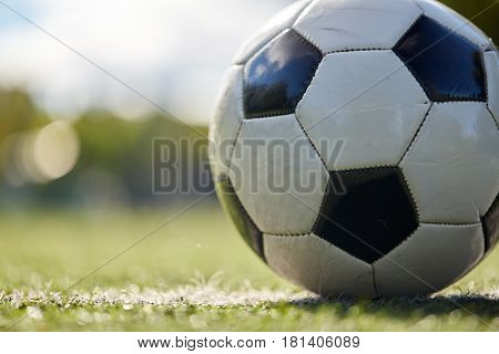 sport, soccer and game - close up of ball on football field