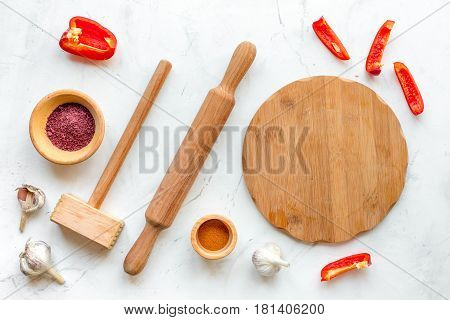 Professional kitchen with rolling-pin for cook concept on white desk background top view
