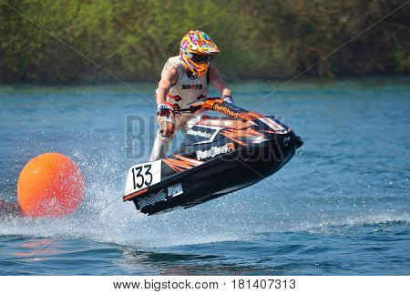 WYBOSTON, BEDFORDSHIRE, ENGLAND -  APRIL 09, 2017: Jet Ski going over jump  at speed.