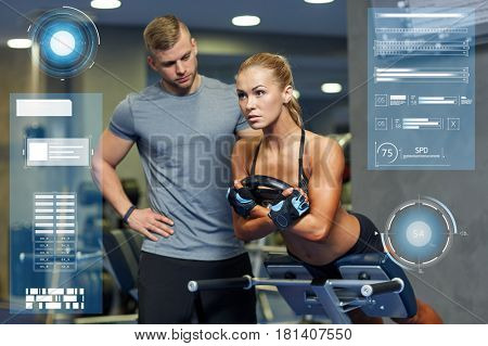 sport, training, fitness and people concept - young woman with personal trainer flexing back and abdominal muscles on bench in gym over virtual charts