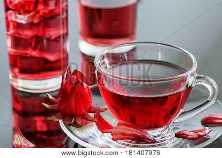 Cup Of Hibiscus Tea (rosella, Karkade) On Table