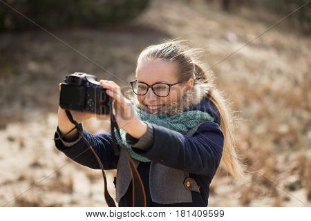 Beautiful Girl With Glasses In The Wind