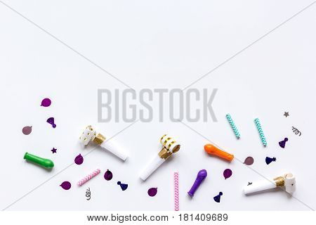 Colored party confetti on white table background top view mockup