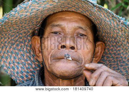 Old Asian Men Smoking portrait of asian senior adult with cigarette