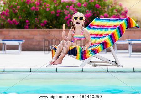Child Eating Ice Cream At Swimming Pool