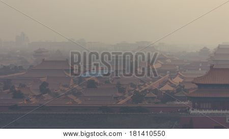 High and wide angle horizontal shot of the Forbidden City in Beijing China on a foggy day.
