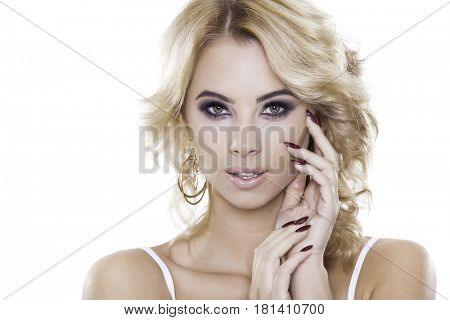 Close up portrait of beautiful blonde woman wearing jewelry isolated on white background