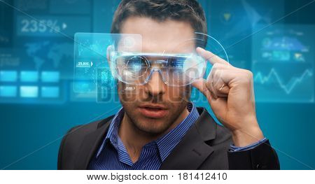augmented reality, technology, business and people concept -businessman in virtual glasses looking at screen projections over blue background