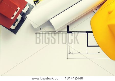 architecture, building, construction, real estate and home concept - close up of architectural blueprint and tools